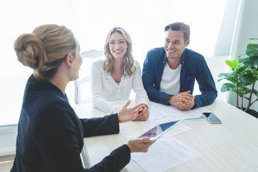 A realtor explaining the prequalifying process to a couple